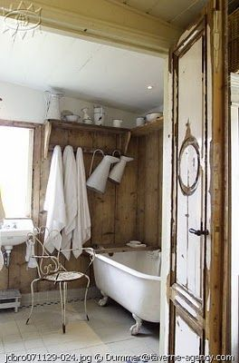 key element: the rustic nature (antique tub, wooden walls, towel racks, simple sink). great carriage house restroom.