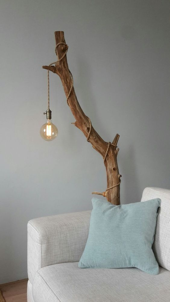 Cover a stained tree branch with an industrial pendant light with a string and a ...