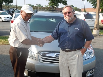 Folger Subaru Sales Consultant Bill Barber with Mr. Miller and his new 2011 Subaru Forester!