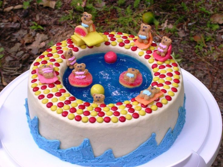 This has been one of the cakes that have gotten more compliments. Directions from the Woman's Day website (Fun-In-The-Pool Cake). It's 2 8-in layers. The top one was hollowed out. I covered them all in buttercream and then made blue Jell-O using the quick-set method, filled the pool, and into the fridge it went until it was completely set. I used mini M&M's for the tiles because I couldn't find Chiclets. Bears are Teddy Grahams that I decorated with royal icing. Toys and towels were made ...