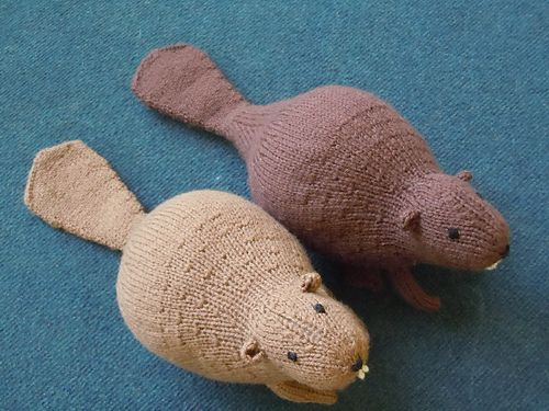 Liam's Beaver is a loveable, huggable toy knit in the round. Although the body is knit in stockinette, the pattern uses linen stitch to create a dense, sturdy tail. Eyes, nose, and teeth can be embroidered on, or made with buttons, fabric, felt, etc. Finished size is 16 inches long from nose to tip of tail, and 6 inches tall from top of head to floor.
