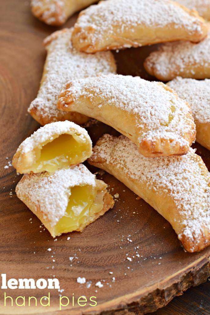 Lemon Hand Pies: flaky, baked hand pies with a sweet lemon filling! Don't forget the dusting of powdered sugar on top!