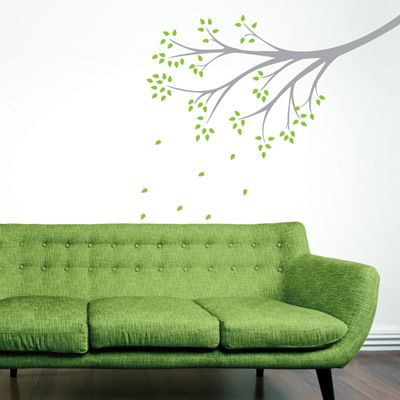 relax in your room while reading a book under an adorable delicate whimsical tree branch wall decal from dali decals