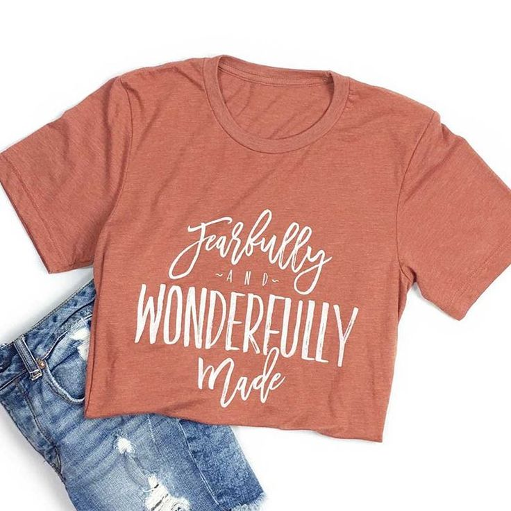 """A """"fearfully and wonderfully made"""" design on a clay unisex tee with a white…"""