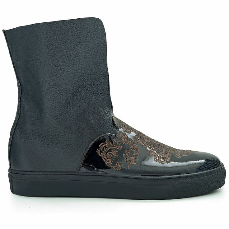 Sneaker boots inspired by Islamic art. Made from natural black leather and…