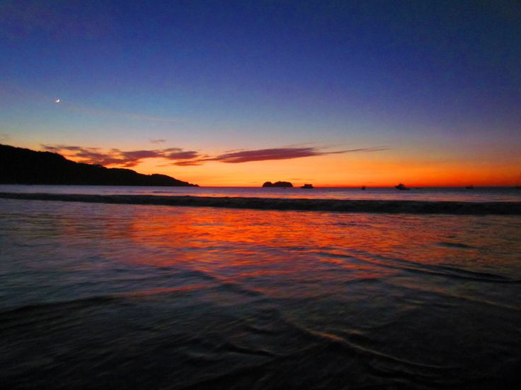 Sunset Playa Hermosa Guanacaste Costa Rica with the moon following close behind