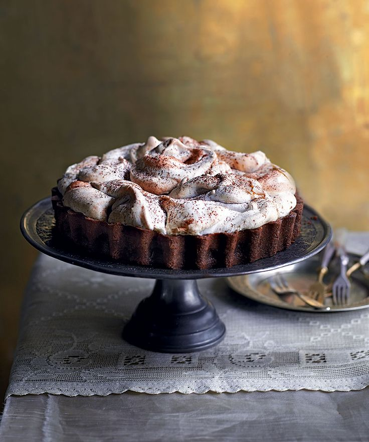 A crisp, chocolate pastry case is filled with a chocolate truffle filling and topped with light-as-air meringue. A showstopper dessert for any dinner party.