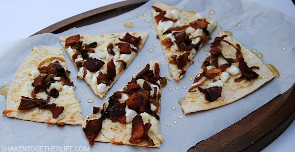 Need an appetizer to wow your guests? Make a few of these Bacon, Goat Cheese & Caramelized Onion Flatbreads, drizzle with honey and watch them disappear!