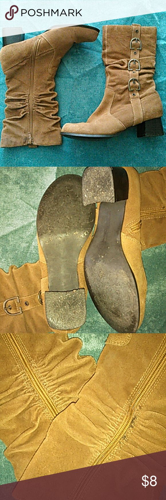 (4 for $13) Brown tan zip up boots Pre loved. Rouching near zipper. Buckle decoration.  Flaws: some black on the rouching near the zipper. White scuffs on heel. There is general wear on these on the material, they still look good though, and have a lot of life left. They go half way up the calf. Can also fit a 6.5, I am 6.5 and they fit me. MIA Shoes Heeled Boots