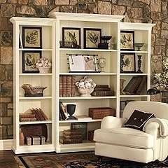 Add Crown Molding to top and bottom of Target bookcases to create a designer look. For playroom bookshelves.