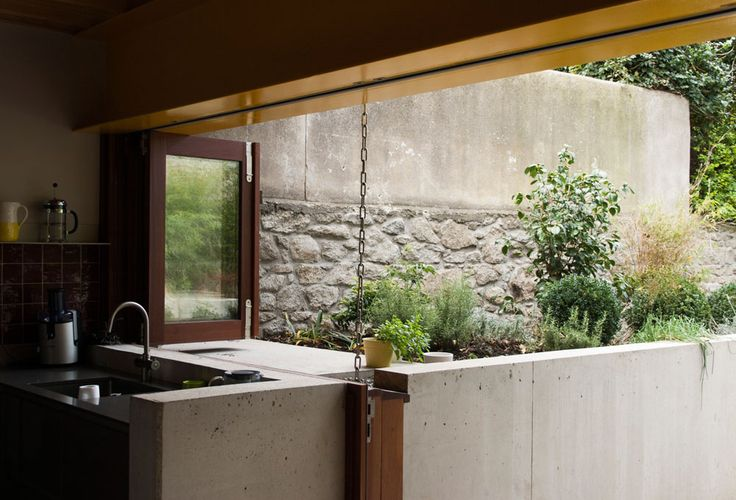 Taka extension - inside/outside kitchen-courtyard.