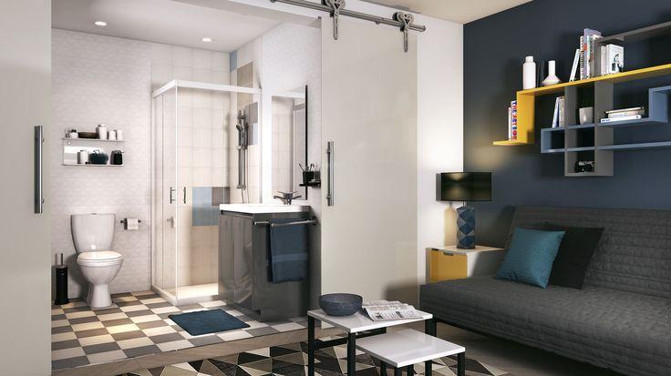 Gris et blanc sous formes géométriques, pour cette salle de bain : jeu de damier au sol, uni pour le meuble et la douche. Une troisième couleur coordonnée (nuance de bleu, jaune, orange, vert ou noir) accessoirise la salle de bain et permet de la personnaliser.
