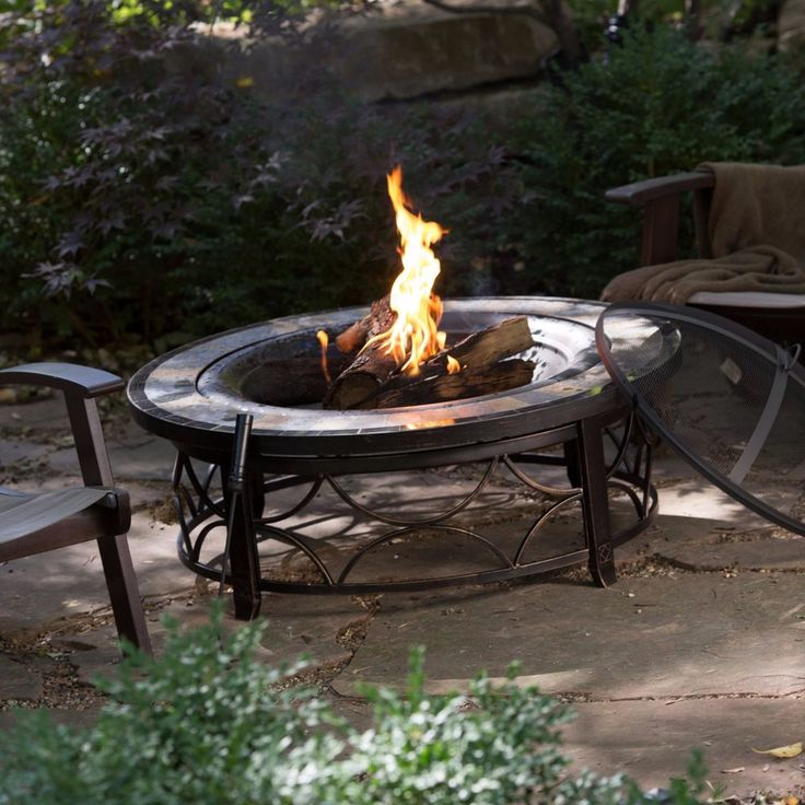 Charming Round Slate Top Fire Pit Table With FREE Cover   A Stone U0026 Tile Outer Rim  Accents Classic Antique Bronze Finish To Make The Red Ember Brighton ...