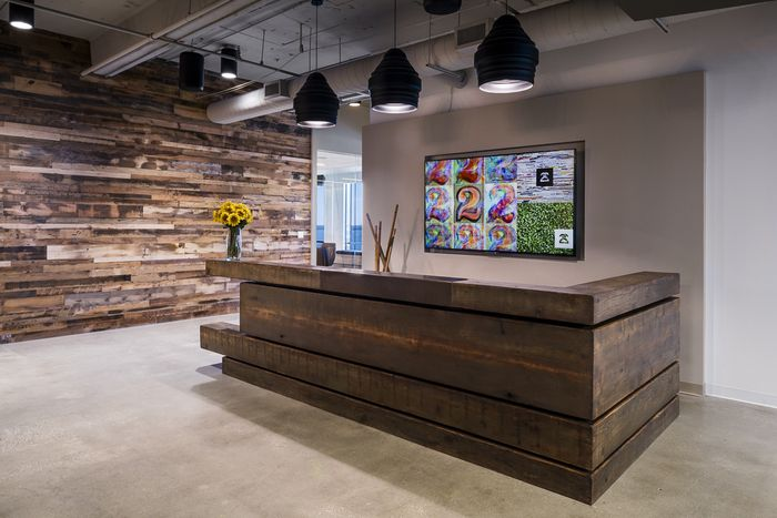 Give your office a unique feel by using different types of wood to create a beautiful natural contrast. This reception desk looks stunning!