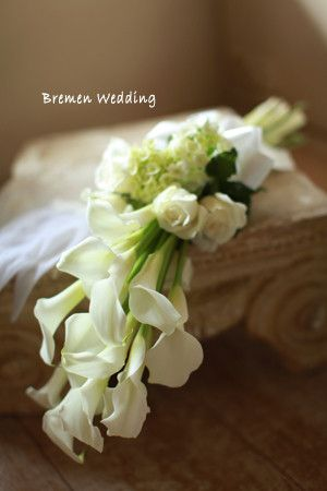arm wedding bouquet of white calla lilies and white roses