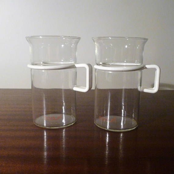 $12  This is a set of 2 Bodum Glass Coffee Mugs with White Handles. The Mugs are a large sized mug and are made of glass with a plastic removable handle that makes cleaning the mugs easier.