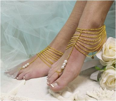 Tap into your inner goddess wearing our trendy barefoot sandals in gold. A…