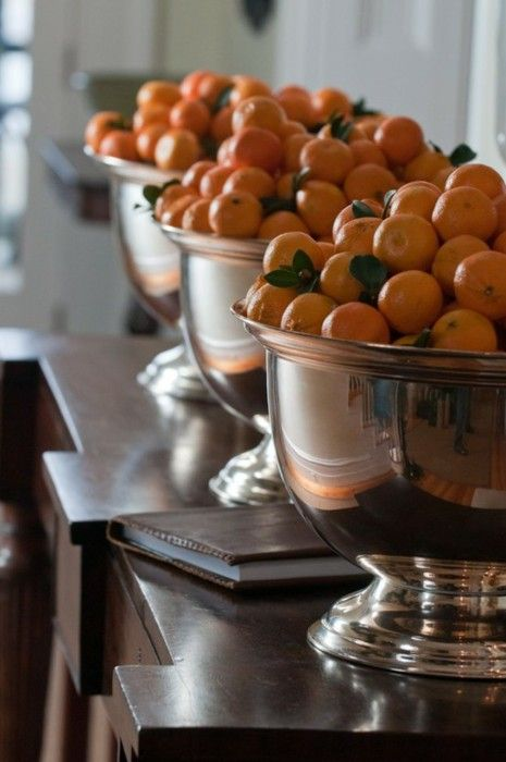 I love the silver punch bowls with the oranges in a group of 3!