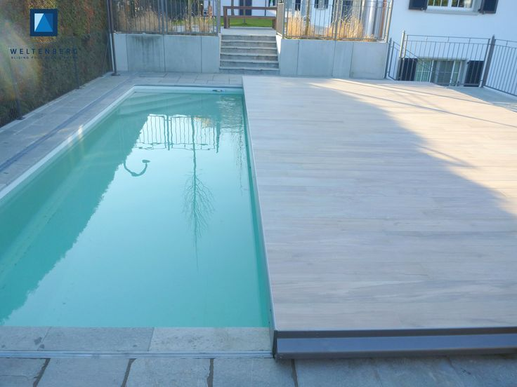 Sliding swimming pool cover and terrace, moveable pooldeck, begehbare Schwimmbadabdeckung, Schwimmbad Terrasse Automatic movement with electric drive ---------------------------- Covering: porcelain stoneware with wood pattern --------------- Size: 8,6 x 4,6m ---- Total height from ground: 17cm ----------- Total load capacity: about 6'000kg ----------------------------------- Proudly produced in Switzerland by www.weltenberg.ch