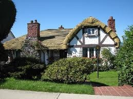 A cozy English Tudor cottage provided the model for this cute fairy-tale residence, one of three put up by builder Brenton T. Lea.  The undulating shingle roof convincingly imitates thatching. This portion of King Edward Avenue (25th Avenue) marks the transition from the historically affluent West Side to the more basic amenities of the East Side.
