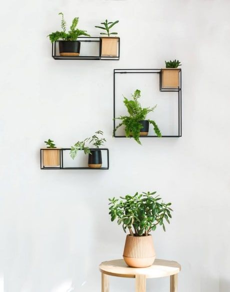 A stunning and handy rectangular box shelf with planter. These shelving units are functional yet have a modern and minimalist design. Available in a white or black metal finish and each with a removeable wooden planter. Click through to shop.