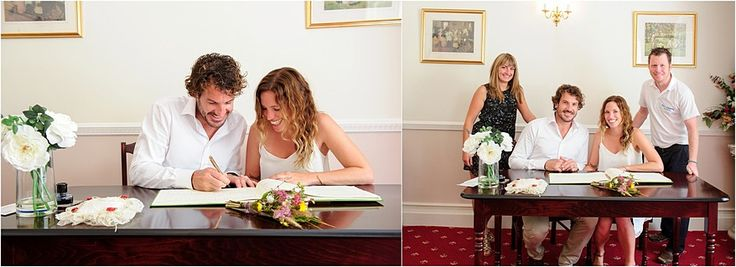 signing of the register at Penzance Registry office wedding