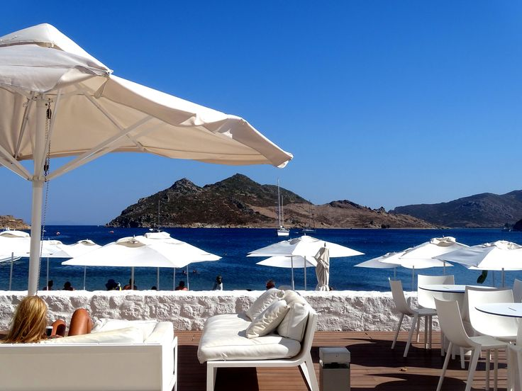 «Theion» bar is in total harmony with the natural environment and the traditional architecture of the area. «Theion» offers high quality services, serving the hotel's guests who unwind in the internal or external area, enjoying the comfortable sun beds. #patmos #patmosaktis #theionbar #theion #grikos #beachbar More: http://goo.gl/tiM3It
