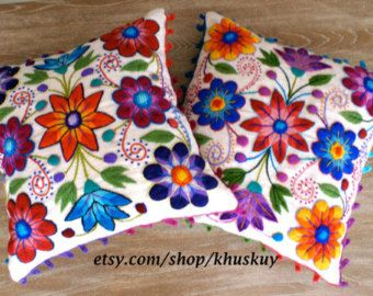 Vibrant, colorful flowers pop beautifully from the green background of our hand embroidered cushion cover. Our pilllows are first woven on a traditional