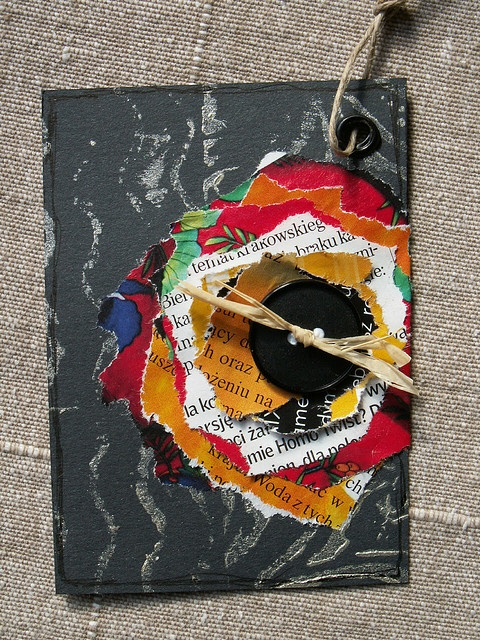 Recycle magazine pages into layered flowers on an ATC