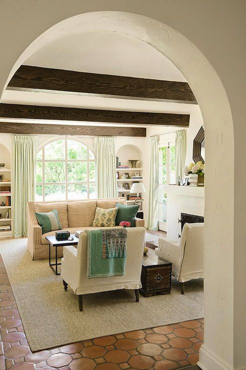 Contemporary Mediterranean Living Room Design With Dark Wood Beams And Hex Terracotta Tile Floor