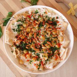 Tastespotting Arabic search. Fattet Hummus Bel-Laban - dish made of layers (toasted Arabic flat bread, yogurt sauce, chickpeas)