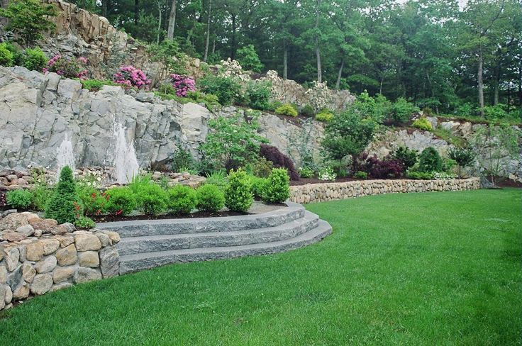 Work with your incline and stone to create a unique space for Unique front yard landscaping ideas