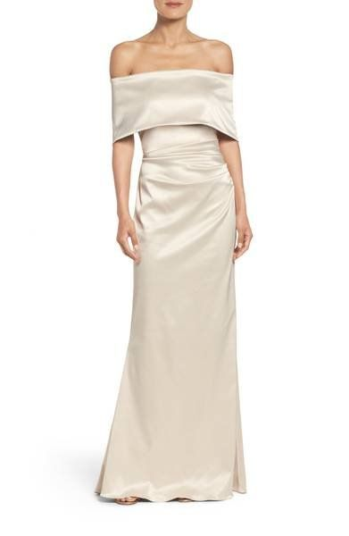 Lustrous satin multiplies the glamour of this ruched, shoulder-baring gown flared by a fishtail train.