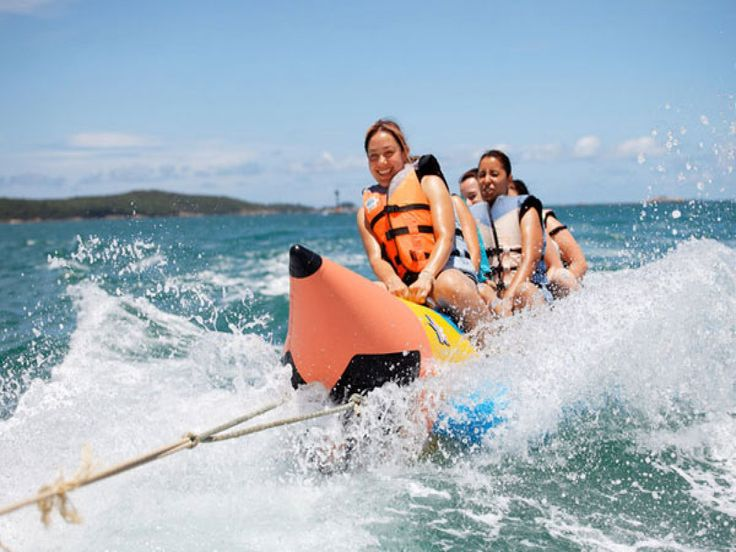 Banana boating is another fun activity that you can try here. Up to 4 people with minimum age limit of 6 years old can join at once in it. They will ride an inflatable raft, which shape is quite simil - - YukmariGO.com