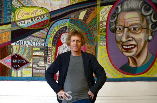 Grayson Perry poses in front of 'Comfort Blanket' during a photocall for his Channel 4 series Who Are You? at the National Portrait Gallery, London.