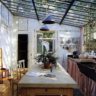 island. glass ceiling, plant, hanging hooks. ect ect