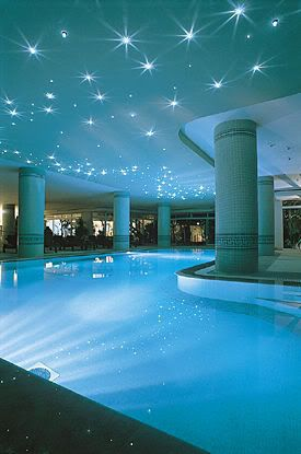 pool with star like lights above. In my dream house, those lights would form constellations/the night sky.