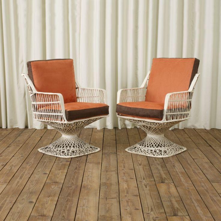 A fun pair of spun fibreglass garden chairs. Newly reupholstered in a wonderful orange