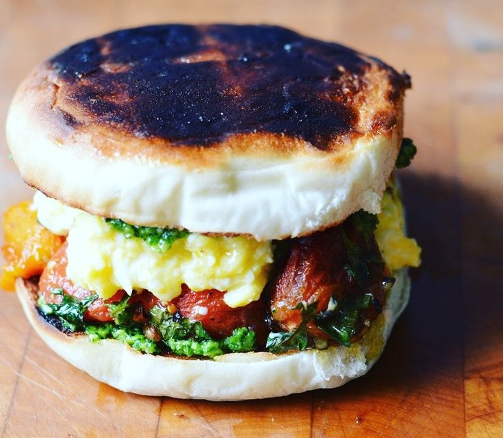Kale pesto and roasted tomato egg sandwich on a Portuguese roll. Breakfast, yo! On 300sandwiches.com.