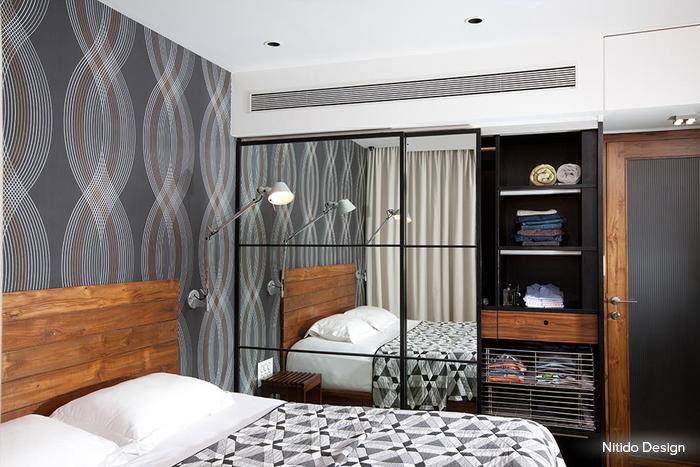 A visually stunning bedroom, with clean contemporary design and a strategic use of mirror that adds space to the interiors#bedroom #homedecor #gray #contemporary  Design Courtesy - Nitido Design, Mumbai