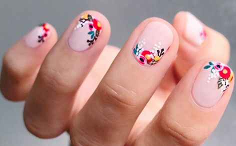 Take a look at these gorgeous, intricate floral nail designs. They'll inspire you to rock some flower nail art this Spring.