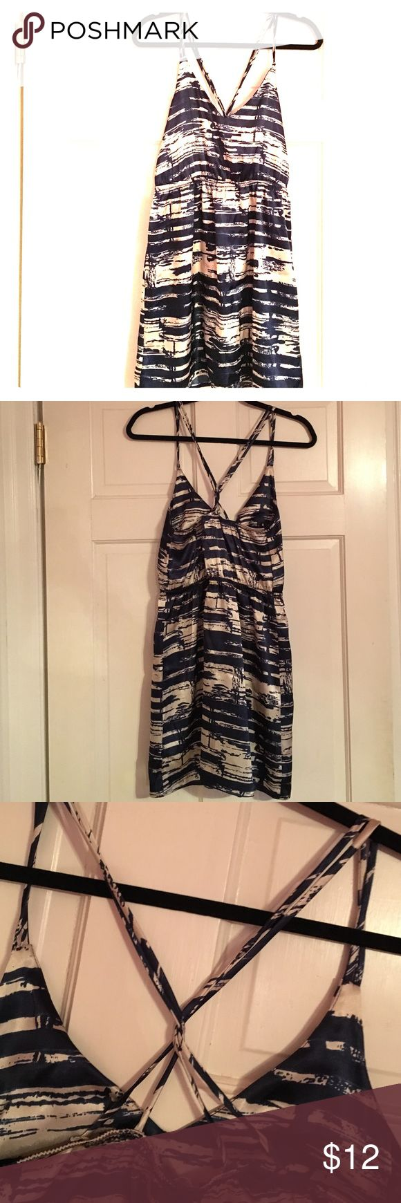 Silk sundress Navy blue and white silk sundress with criss-cross back. Great for a casual night out or comfortable day attire. Dress down with flats or dress up with some jewelry and a pair of heels! Dresses Mini