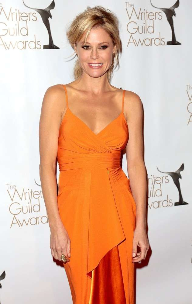 Julie Bowen in Orange Pleated Overlap Dress