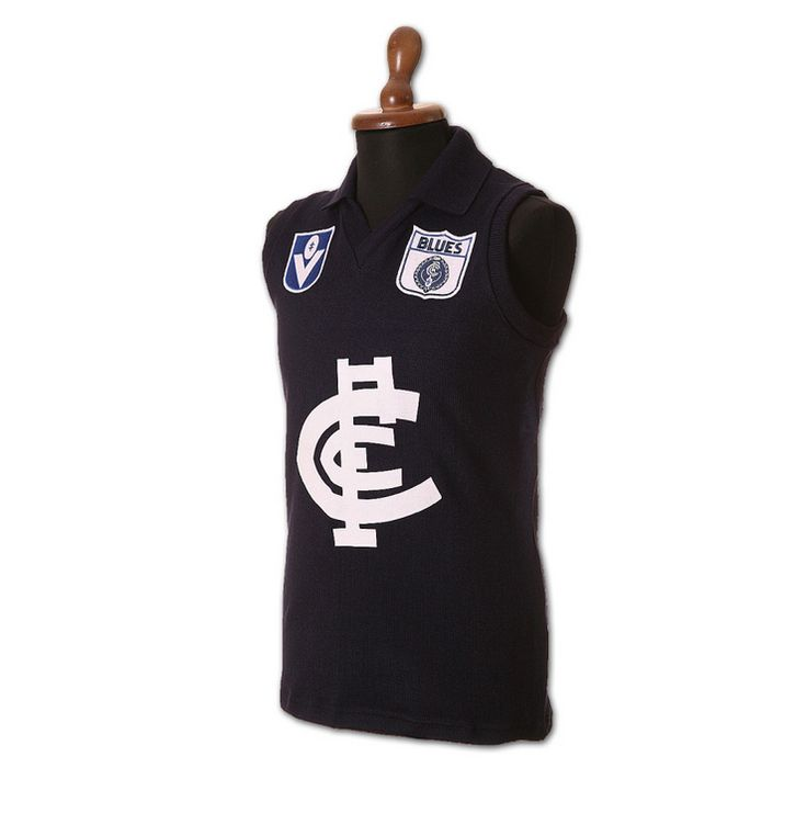 Fibre of Football Carlton Guernsey. The Merino wool in these products was grown by sheep grazing the Australian landscape, cared for by Australian farmers, shorn by hand and eventually manufactured in Australia.
