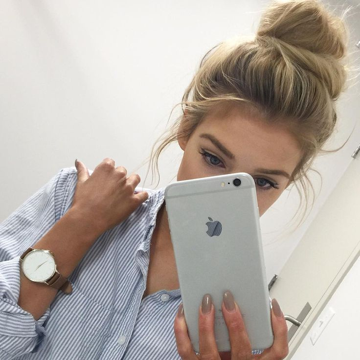 I love everything about this picture. Her hair, nails, watch, shirt, phone, makeup
