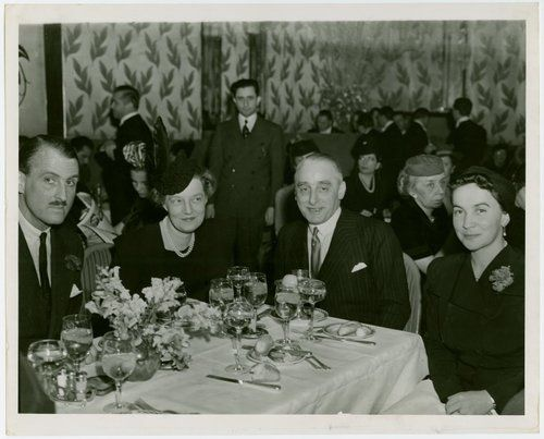 Prince Serge Obolensky, Grand Duchess Maria Pavlovna of Russia, Nicholas G. Lely (Consul General of Greece at New York) and Princess Filippa of Braganza at Greek fashion show, St. Regis Hotel, ca. 1940