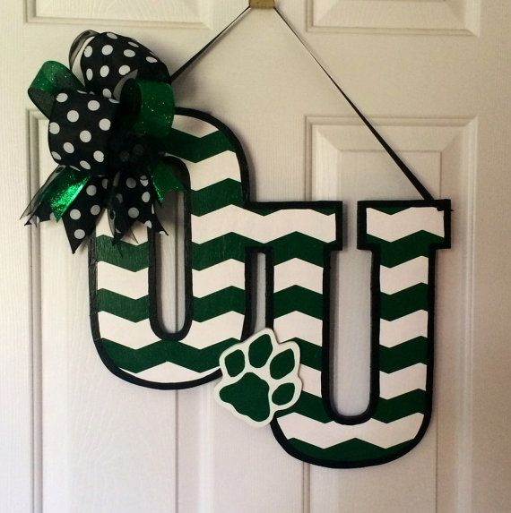 Hand painted Ohio University wooden door hanger. Sprayed with weather proof top coat.