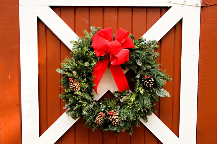 The Classic Holiday Wreath, complete with a big red bow and a few pine cones.