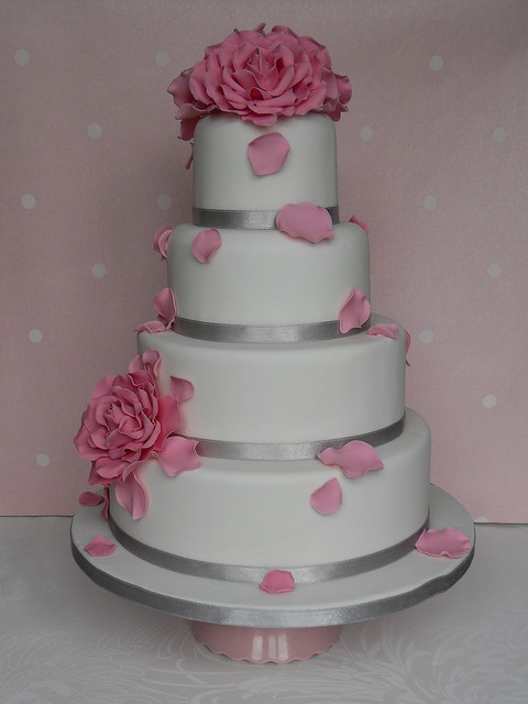 Pink petal cake hhhmm i like the simpleness of the white with the silver ribbons but would definitely change it to yellow flowers
