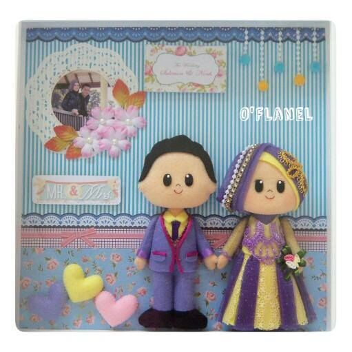 to be put on the wall. Pretty bride groom in purple costumes for wedding.